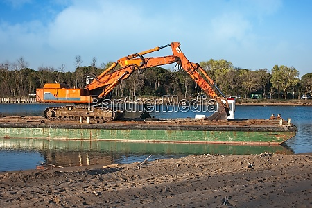 excavator for channel dredge on a