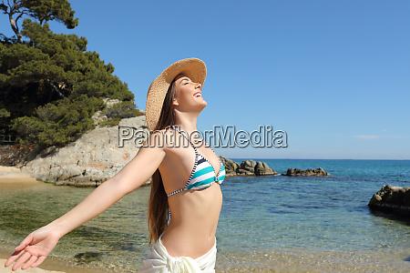 happy tourist breathing deep fresh air