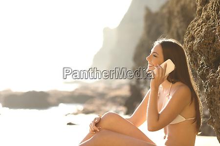 tourist in bikini talking on phone