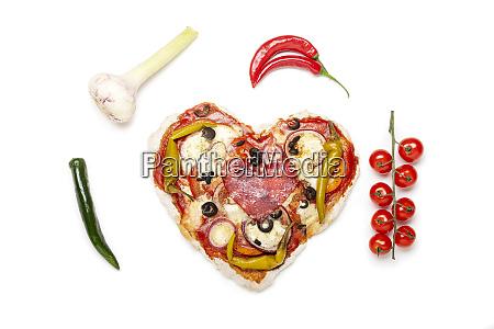 closeup of a heart shaped pizza