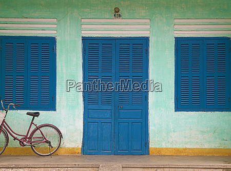 bike parked on a front porch