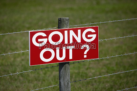 sign on a barbwire fence