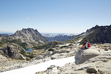 hikers admiring mountains in remote landscape
