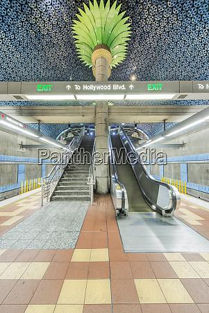 ornate pillars escalator and movie reels