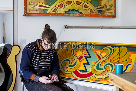 woman artist working sitting by a