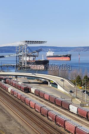 train yard near cranes in harbor