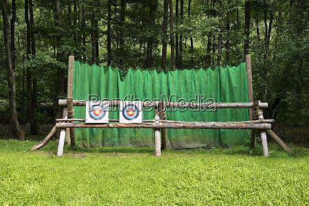 targets on fence at archery range