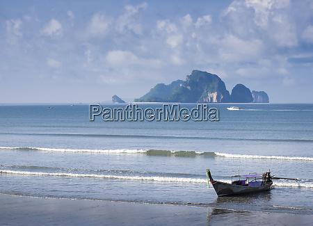 fishing boat moored on beach