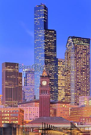clock tower and illuminated high rise