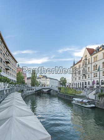 buildings and pedestrian bridge over urban