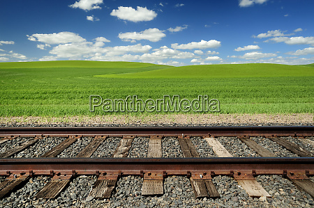 railroad tracks and rolling hills in