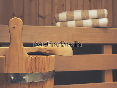 sauna with bucket spoon and towels