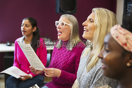 womens choir singing in music recording