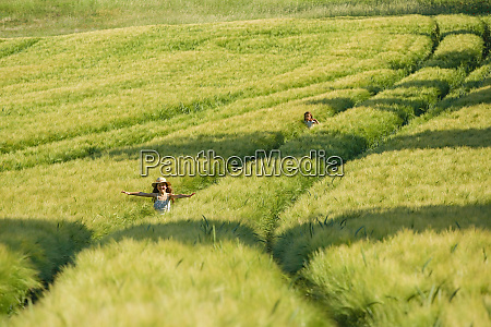 carefree girls running in sunny idyllic