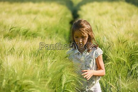 curious girl walking in sunny idyllic