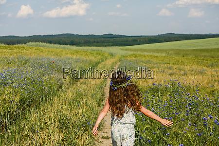 girl running in sunny rural idyllic