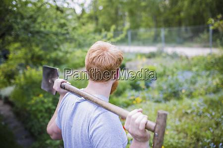 man with shovel in garden