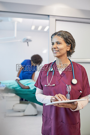confident smiling female doctor with digital