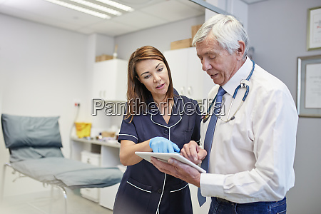doctor and nurse with digital tablet