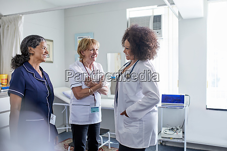 female doctor and nurses talking in