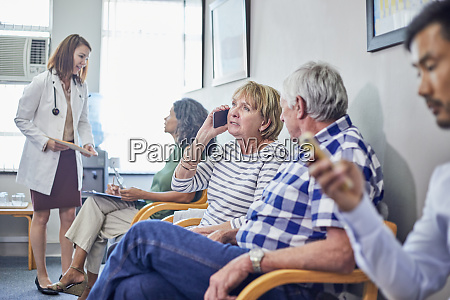 doctor and patients in clinic waiting
