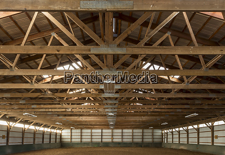 wooden rafters in indoor horse riding