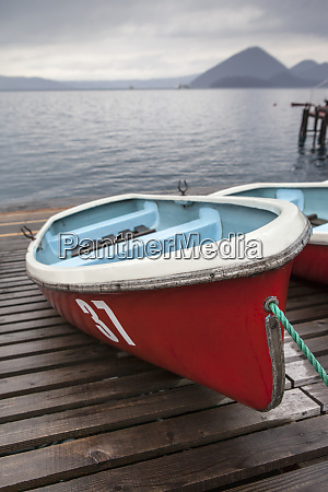 boats on wooden dock