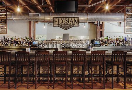 elysian brewing sing over bar
