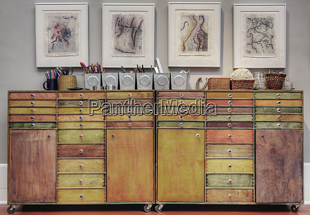 colorful wooden drawers in cabinet