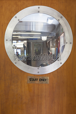 porthole above staff only sign on