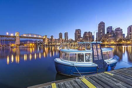 waterfront skyline and harbor illuminated at