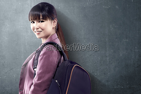 asian student woman with backpack standing