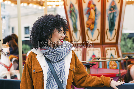young woman by carousel