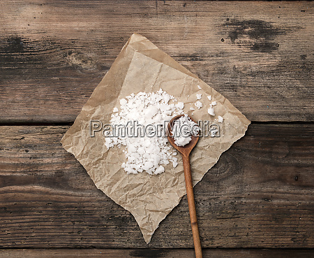 large white salt on a brown