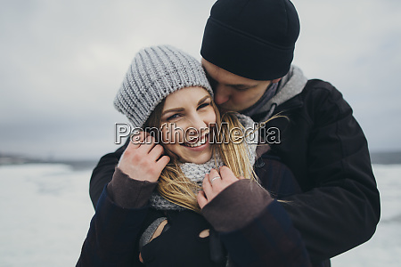 young couple wearing warm clothing