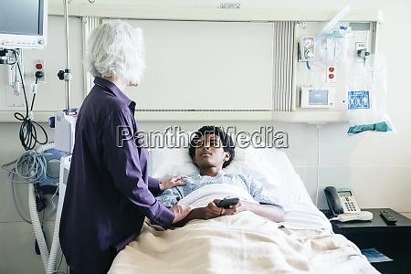doctor comforting teenage patient