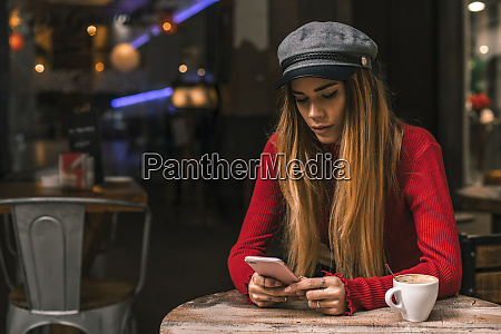 portrait of young woman text messaging