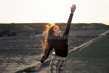 fashionable teenage girl wearing black pullover
