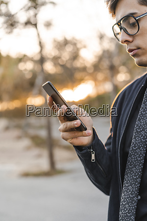young businessman looking at cell phone