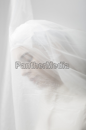 graceful woman trapped in a veil