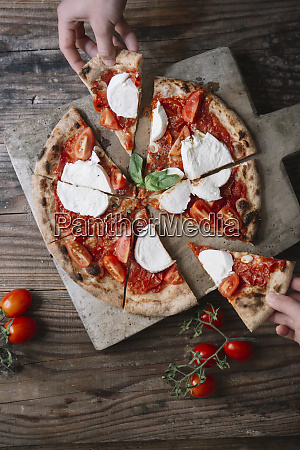 eating a pizza with mozzarella hand