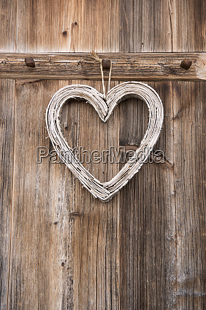 decorative heart hanging on wooden coat