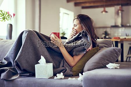 portrait of woman lying sick on