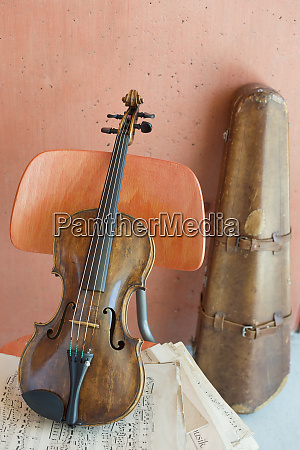 violin and sheet music on wooden