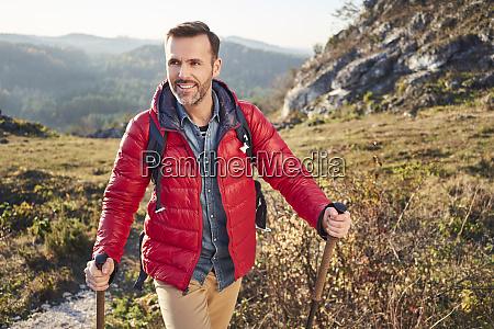 smiling man on a hiking trip