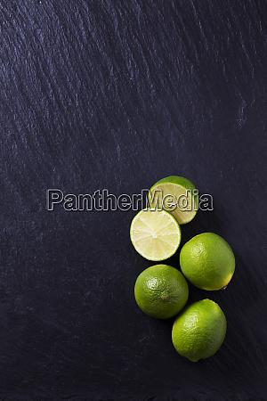 four limes on black slate slab
