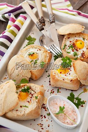 eggs in crunchy bread rolls