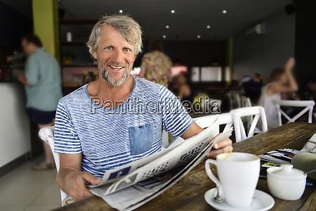 portrait of smiling mature man sitting