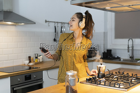 young woman listening musuc in the