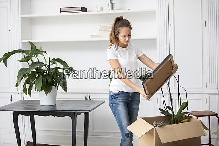 woman packing cardboard boxes